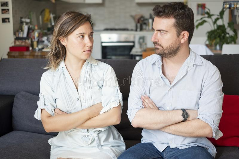 Relationship breakup and couple fighting badly. Young couple arguing at home needs couples therapy stock photo