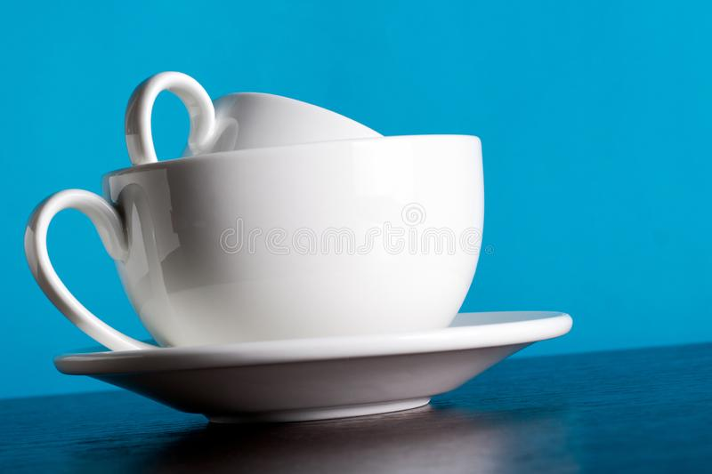 Relationship concept, romance, love. a cup of coffee in a cup. On blue background royalty free stock images