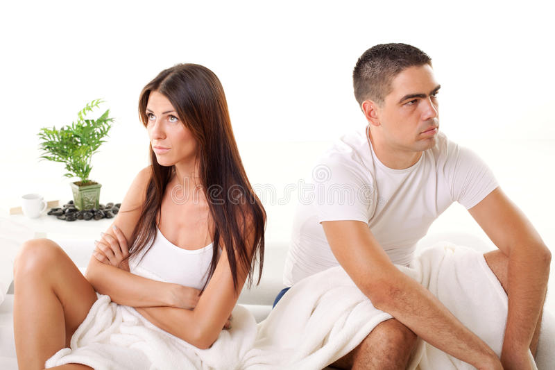 Relationship conflict. Angry Young couple sitting on the bed because of Relationship Difficulties stock photo