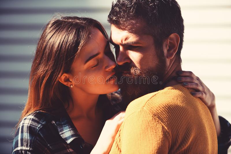 Relationship and dating concept. Girl and bearded guy stock photography