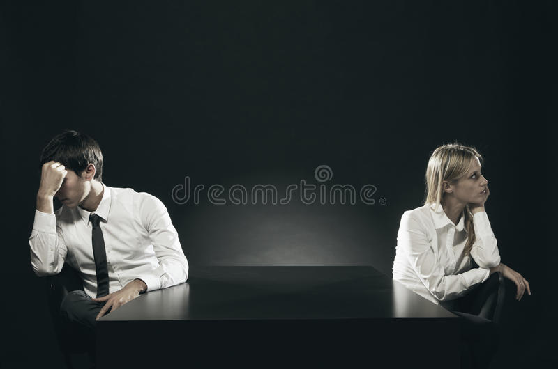 Relationship difficulties. An unhappy or bored couple sitting apart royalty free stock photos