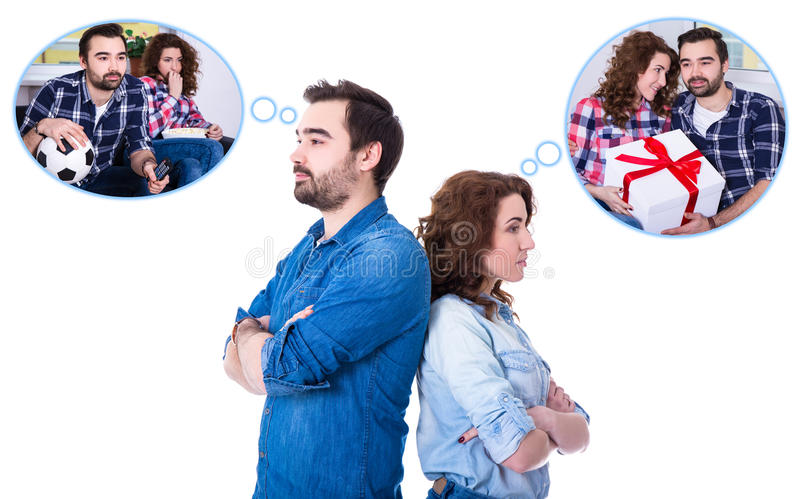 Relationship or divorce concept - portrait of sad young couple d. Reaming about different things isolated on white background royalty free stock photos