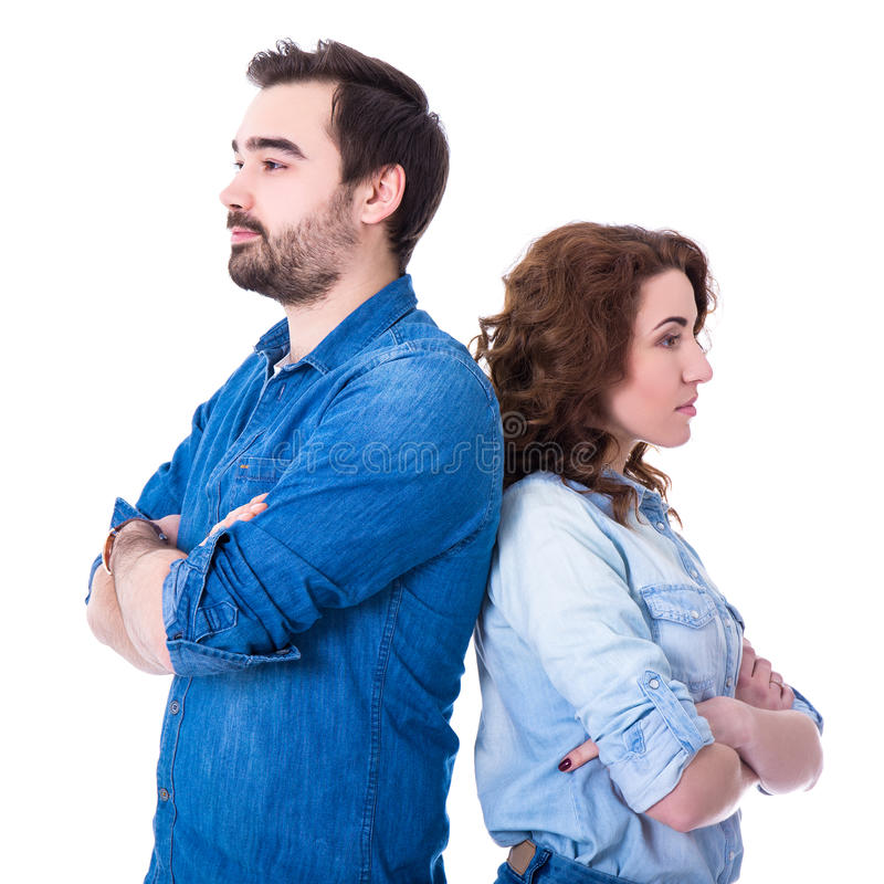 Relationship or divorce concept - portrait of sad young couple i. Solated on white background royalty free stock images