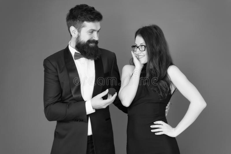 Relationship. love relationship. surprise. bearded man make woman marriage proposal. tuxedo man and elegant lady at stock photo