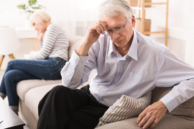 Relationship Problems. Senior Couple After Argument On Sofa stock photos
