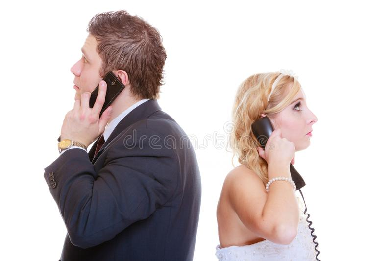 Groom and bride calling to each other. Relationship problems and troubles concept. Groom and bride calling to each other having quarrel argument stock photography