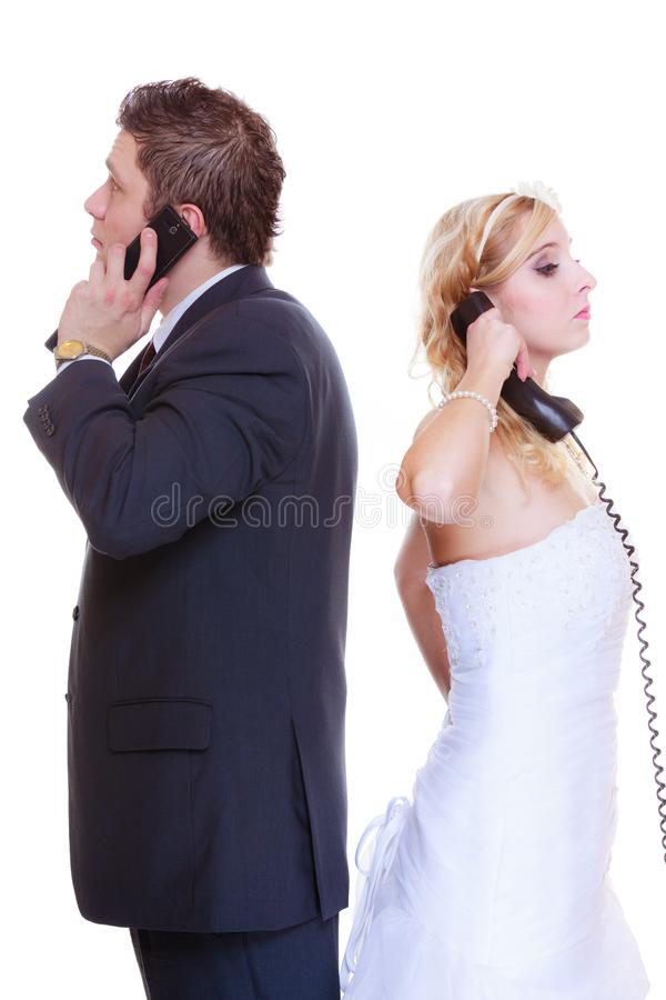 Groom and bride calling to each other. Relationship problems and troubles concept. Groom and bride calling to each other having quarrel argument royalty free stock photography