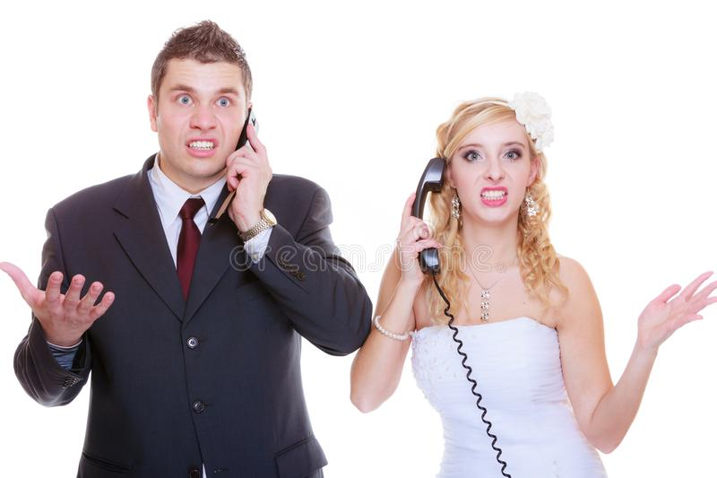 Groom and bride calling to each other. Relationship problems and troubles concept. Groom and bride calling to each other having quarrel argument stock photos