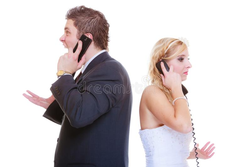 Groom and bride calling to each other. Relationship problems and troubles concept. Groom and bride calling to each other having quarrel argument stock images
