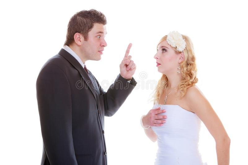 Groom and bride having quarrel argument. Relationship problems and troubles concept. Groom and bride having quarrel argument royalty free stock photo