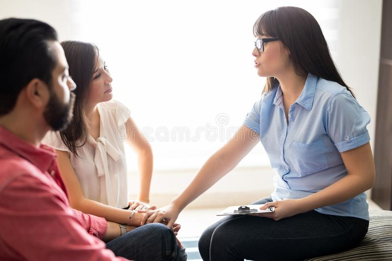 Relationship psychologist supporting conflicted couple royalty free stock photos