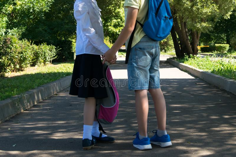 The relationship between school students boy and girl after class royalty free stock photos