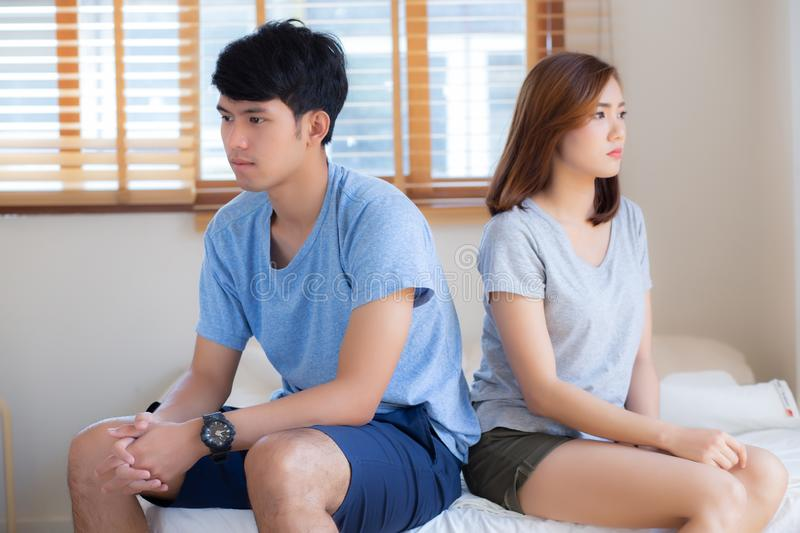 Relationship of young asian couple having problem on bed in the bedroom at home royalty free stock photos