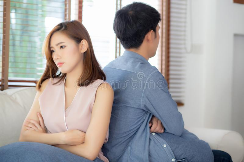 Relationship of young asian couple having problem on sofa in the living room at home royalty free stock images