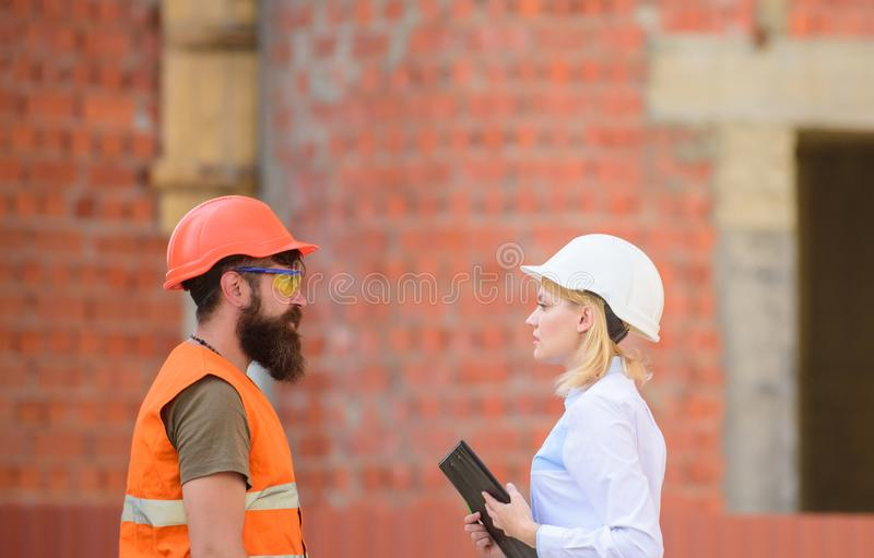 Relationships construction client and participant building industry. Discuss progress plan. Construction industry. Concept. Woman engineer and bearded brutal stock images