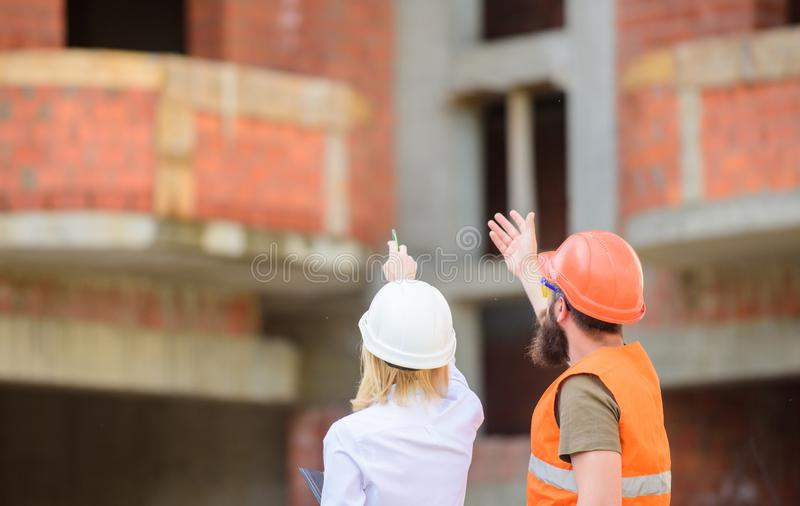 Relationships between construction clients and participant building industry. Construction team communication concept. Discuss progress plan. Woman engineer royalty free stock photo
