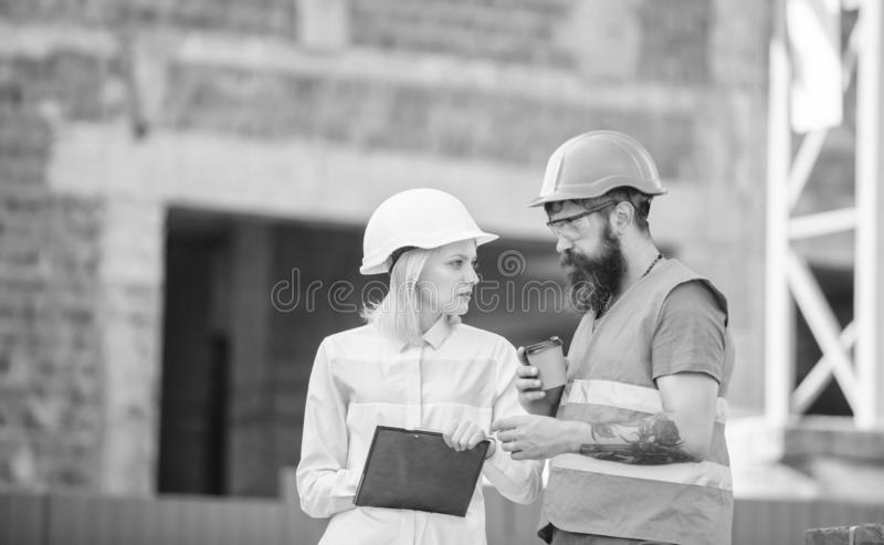 Relationships between construction clients and participant building industry. Discuss progress plan. Woman engineer and. Builder communicate construction site royalty free stock photos