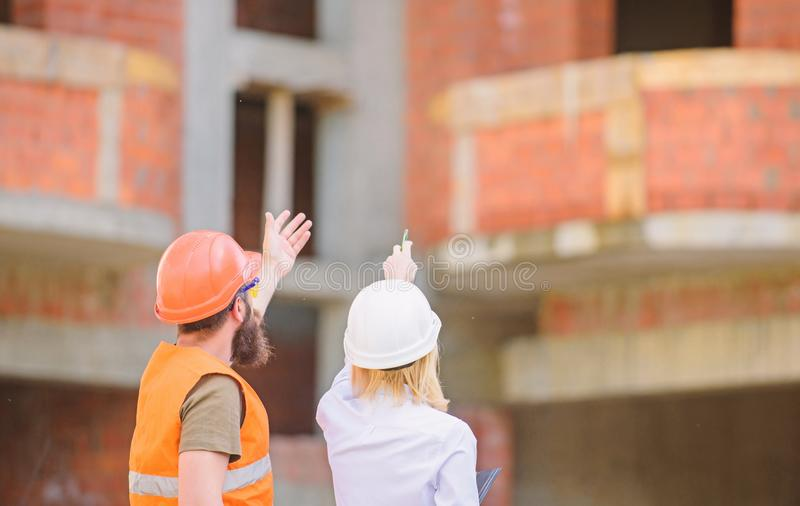 Relationships between construction clients and participant building industry. Construction team communication concept. Discuss progress plan. Woman engineer stock photo