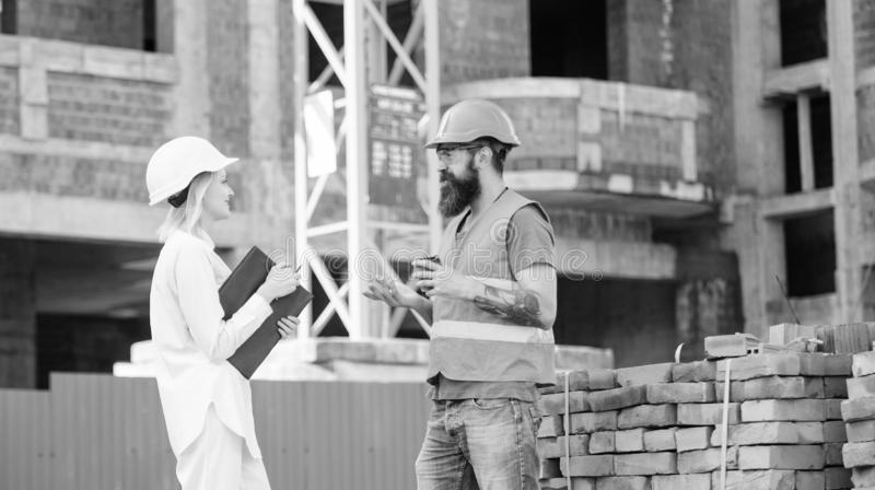 Relationships between construction clients and participants of building industry. Construction team communication stock photos