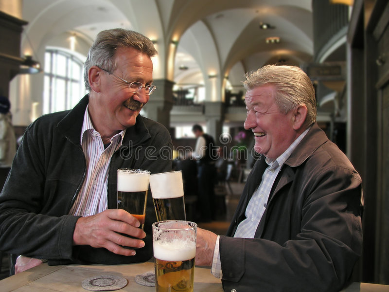 Relatives having fun. Men enjoying a beer in a bavarian restaurant