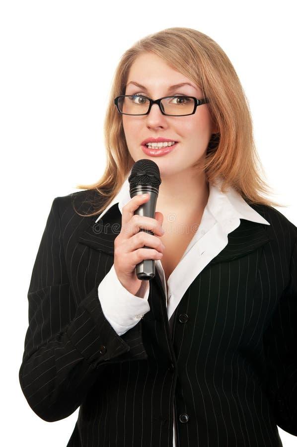 Relatore della giovane donna immagine stock