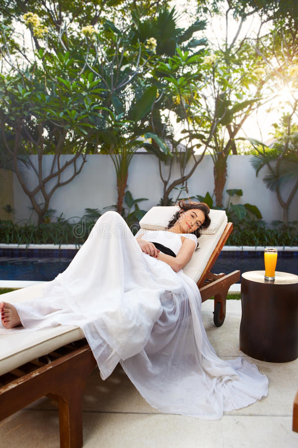 Relax. Young woman relax in the afternoon at Balinese villa stock photos