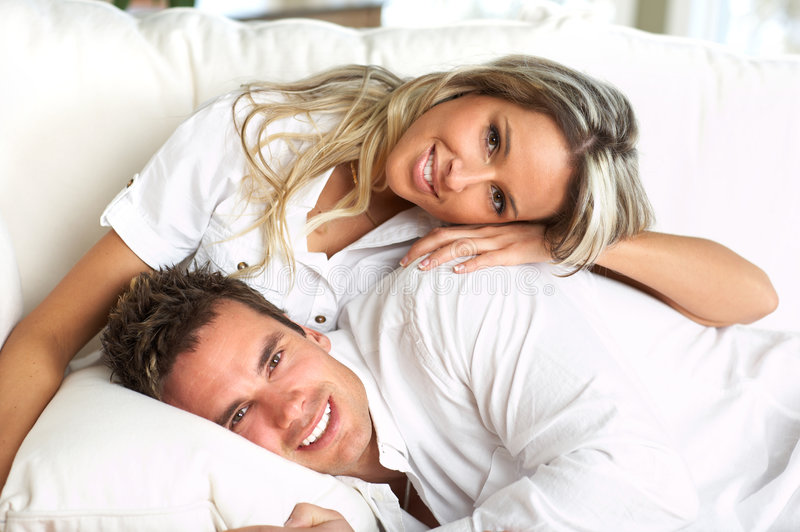 Relax. Young love couple resting in the comfortable apartment