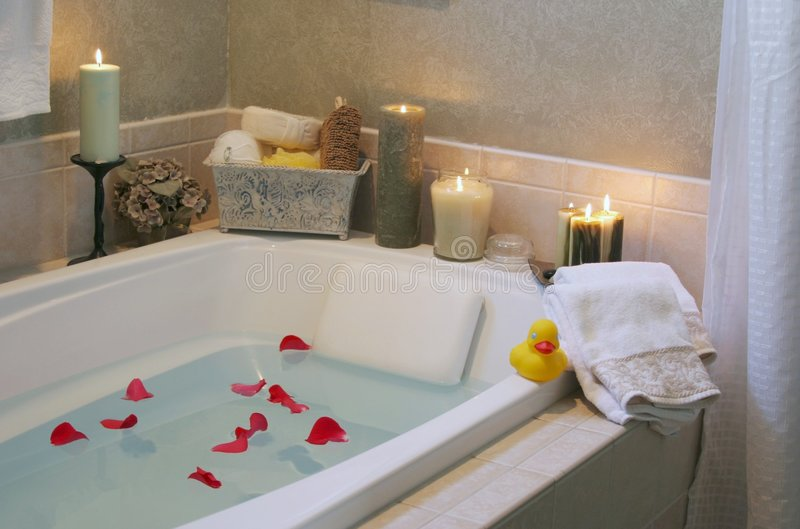 Relax. A drawn bath with candles royalty free stock images