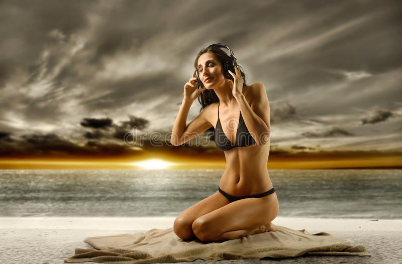 Download Relax stock image. Image of swimsuit, music, skin, bikini - 9563297