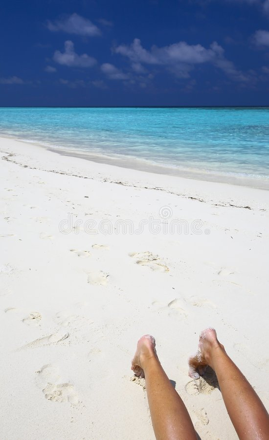 Relax on the beach. Women are realaxing on the sandy coral beach royalty free stock photography