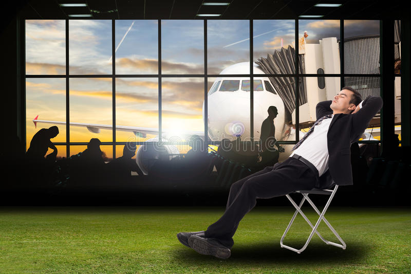 Relax businessman Businessman sitting for going to vaction holiday royalty free stock photography