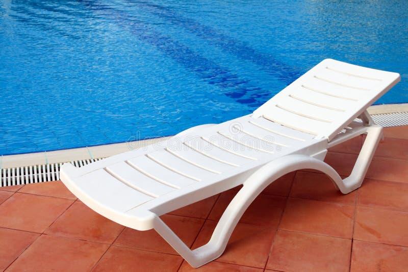 Relax chair near the pool stock photos