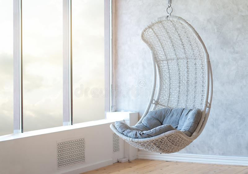 Relax concept with hammock chair in room. Leisure scene with hammock chair with window. Cozy place relax in the room royalty free stock image