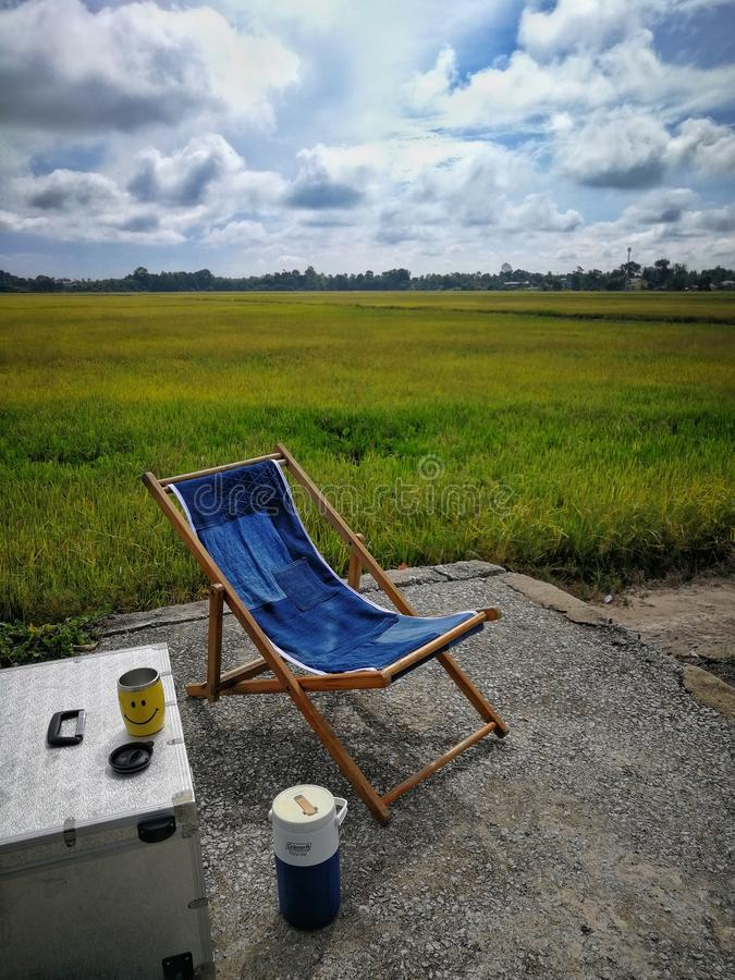 Relax corner in rice field green season. Scenic view of  agricultural landscape. Chair, table royalty free stock photography