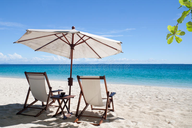 Relax, deckchairs on the beach royalty free stock images