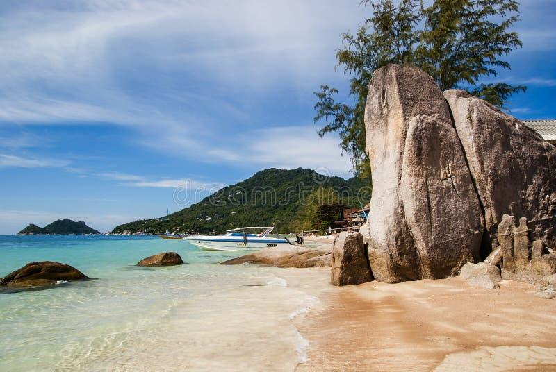 Rocks on white sand Sairee beach at Koh Tao, Thailand stock photo