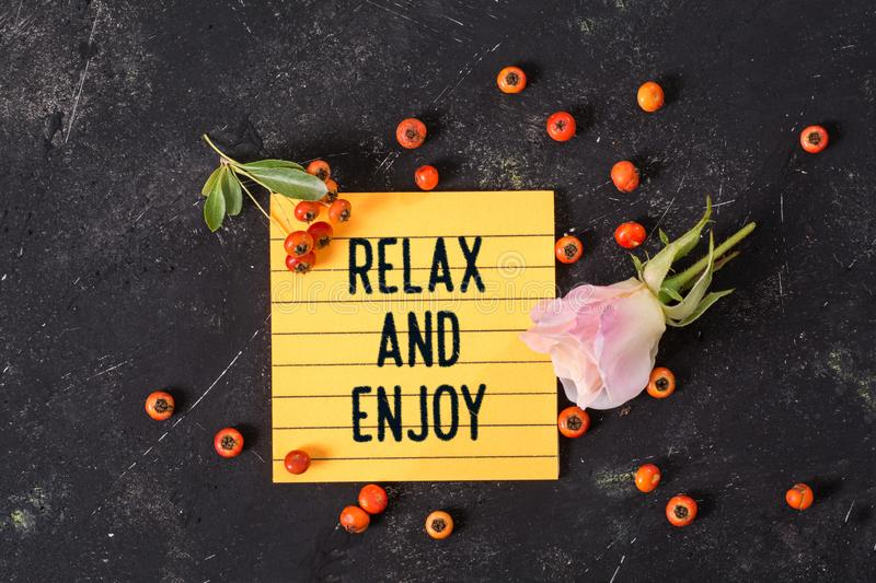 Relax and enjoy text in memo royalty free stock photo