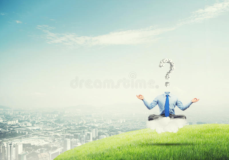 Relax and find solution. Businessman sitting in lotus pose and question mark instead of his head stock photo