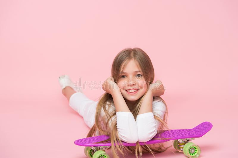 Relax and fun. Happy childhood. Kid girl relax lean penny board. Modern youth hobby. Girlish leisure concept. Girl happy royalty free stock photos