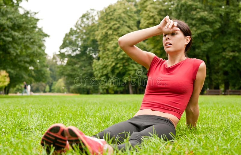 Relax in grass - tired woman stock images