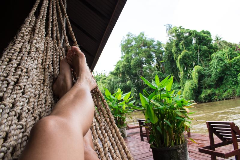 Relax in a hammocks at home in the mountains and the water stock photo