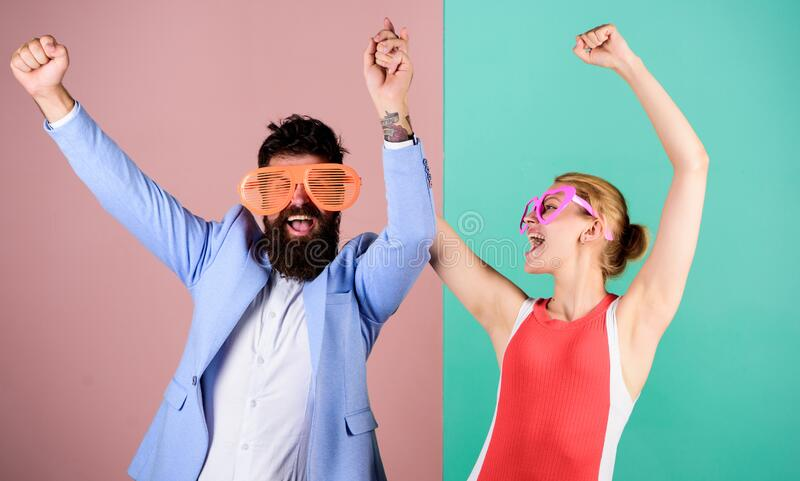 Relax and have fun. friendship. lets celebrate together. party fun. couple in love. hipster guy and girl party glasses royalty free stock photography