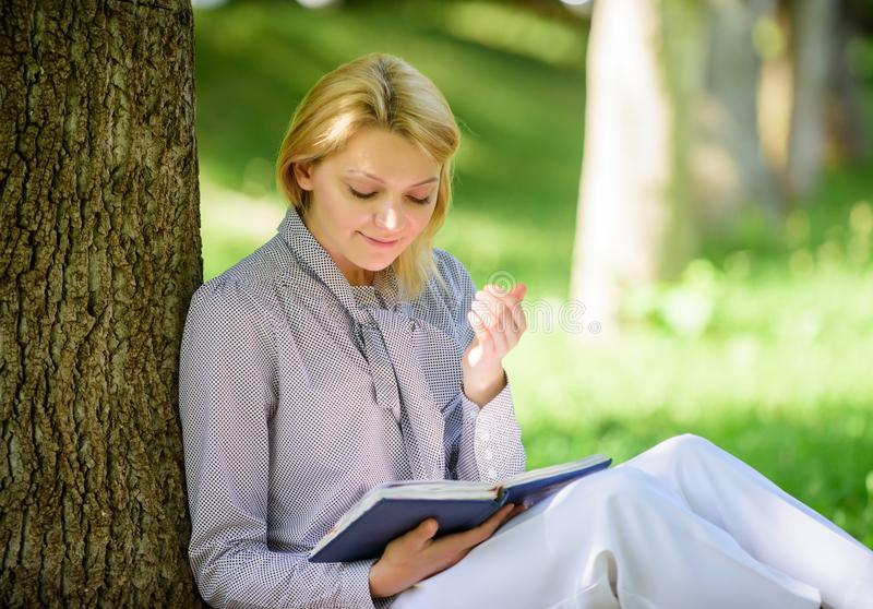 Relax leisure an hobby concept. Best self help books for women. Books every girl should read. Girl concentrated sit park. Lean tree trunk read book. Reading royalty free stock photos