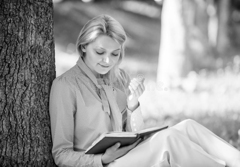 Relax leisure an hobby concept. Best self help books for women. Books every girl should read. Girl concentrated sit park. Lean tree trunk read book. Reading stock photography