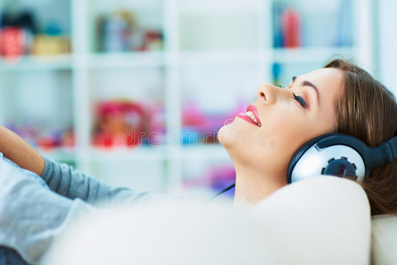 Relax with listening music. Young woman stock image
