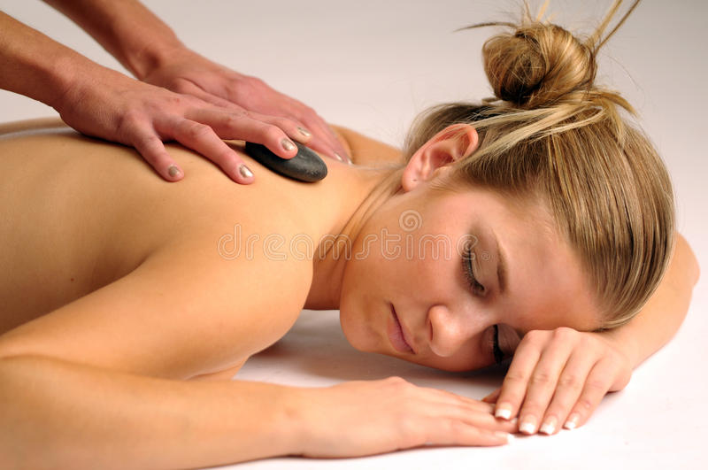 Relax massage. The attractive young woman during the relax massage royalty free stock photography