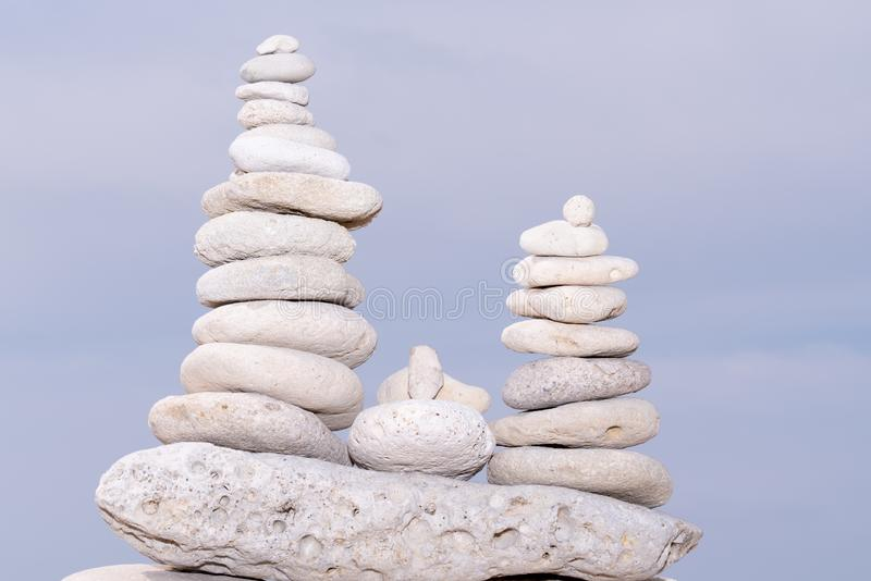 Relax nature concept stack of white pebbles stone against sea background for spa balance meditation and zen theme royalty free stock images