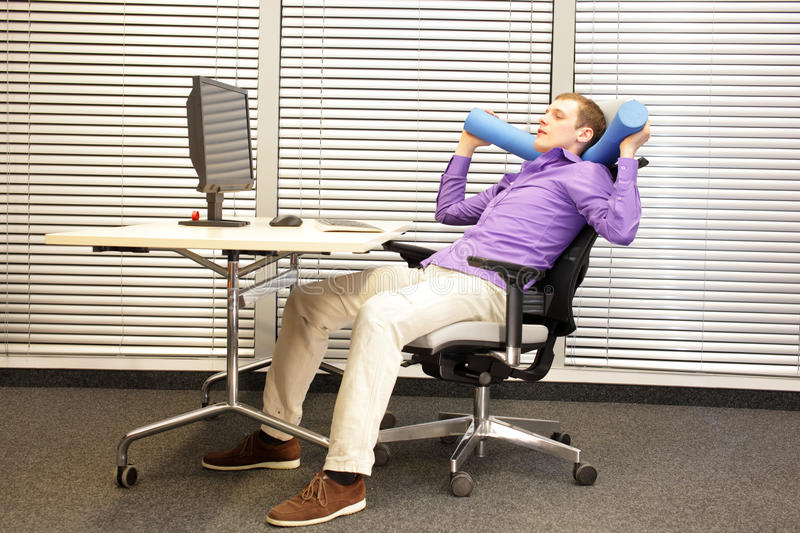 Relax in office work - man at working station stock photo
