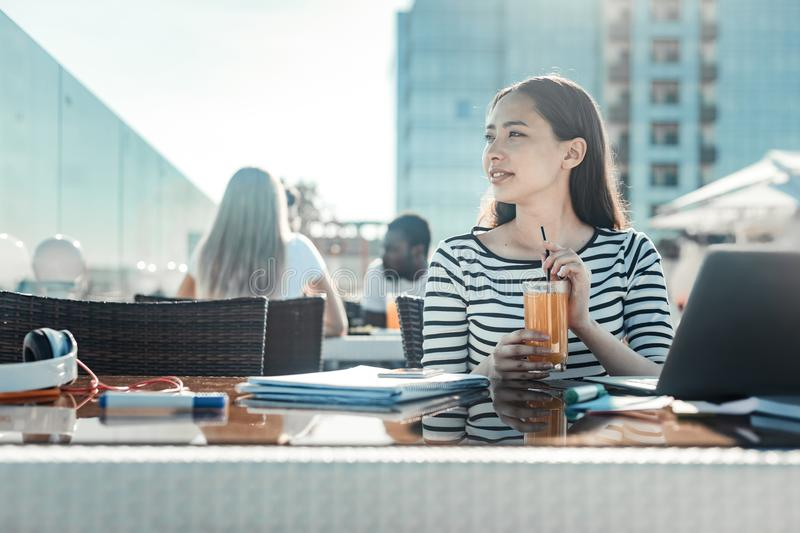 Dreamy girl drinking fresh juice stock images