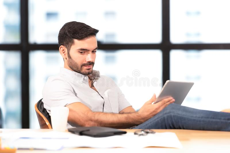 Relax time.  Successful Businessman relaxing  and resting after sitting and hard working in modern office. Healthy care for time. royalty free stock photo